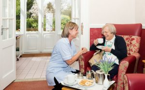Nurse talking to elderly person in The Beeches Residential Home