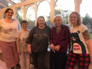 Residential Home Care Team Wearing PJs with Residents